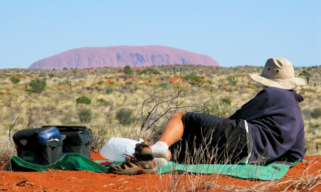 Guy enjoying the view of Uluru