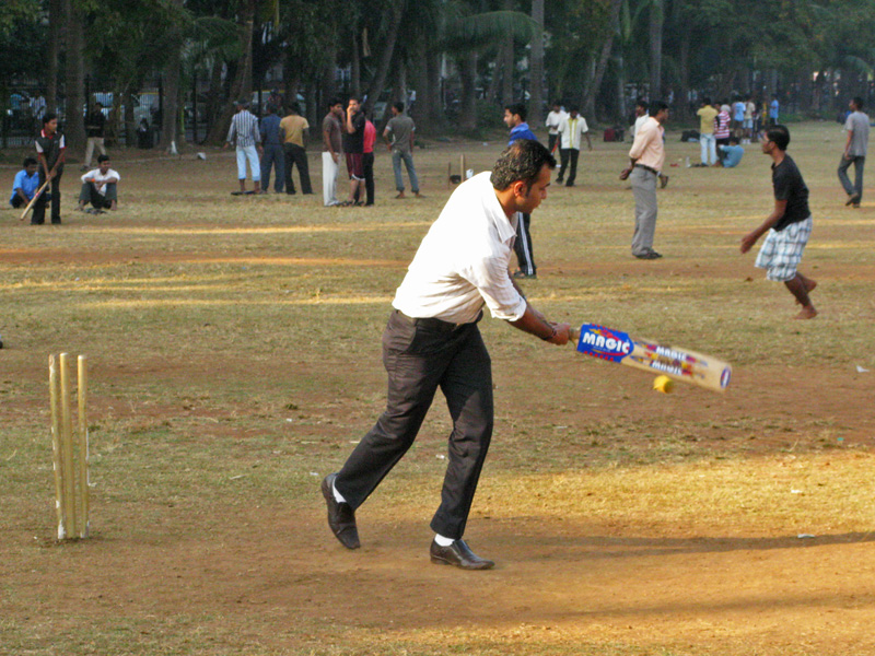 Office man playing cricket