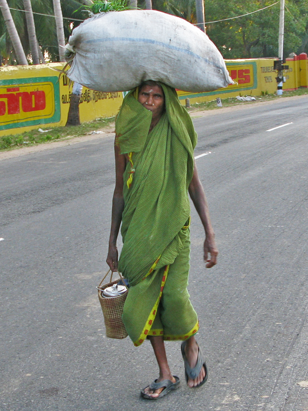 Old lady with heavy load
